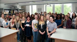 Fashion students presenting a cheque to Jackie Johnston from Strathcarron Hospice