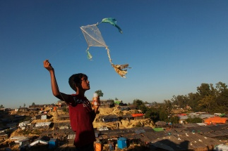 Child playing with a kite made from plastic bags. Daily life in the Kutubalong camp close to Cox's bazaar. Rohingya Refugee crisis, Bangladesh, December 2017